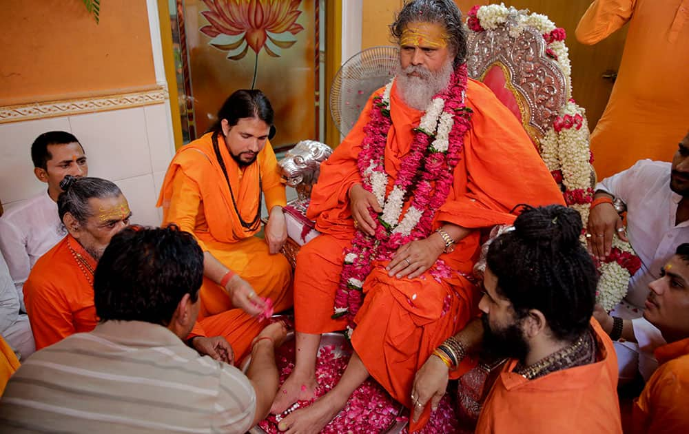 Hindu devotees gather around their spiritual guru on the occasion of Guru Purnima