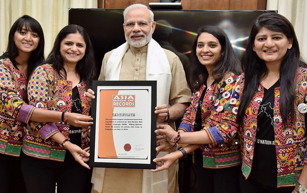 Biking Queens Sarika Mehta, Yugma Desai, Khyati N. Desai and Durriya M. Tapiya meeting Prime Minister Narendra Modi in New Delhi.