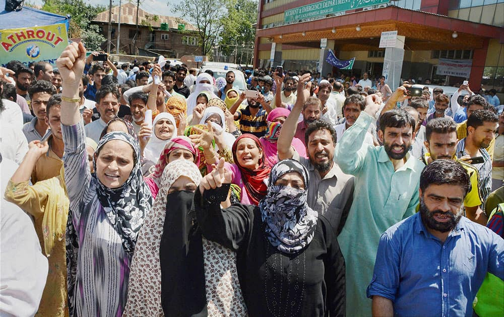 Local people along with attendants of patients shout slogans, Srinagar.
