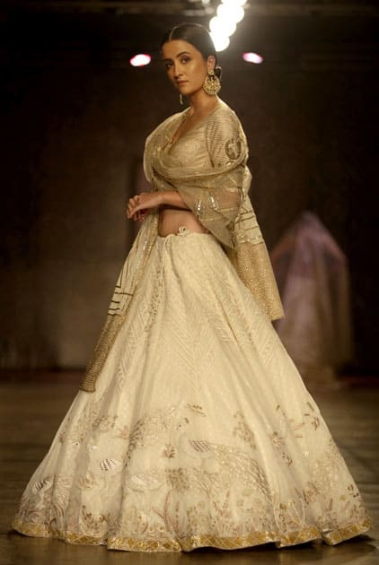A model displays a creation by designers Rimple & Harpreet Narula