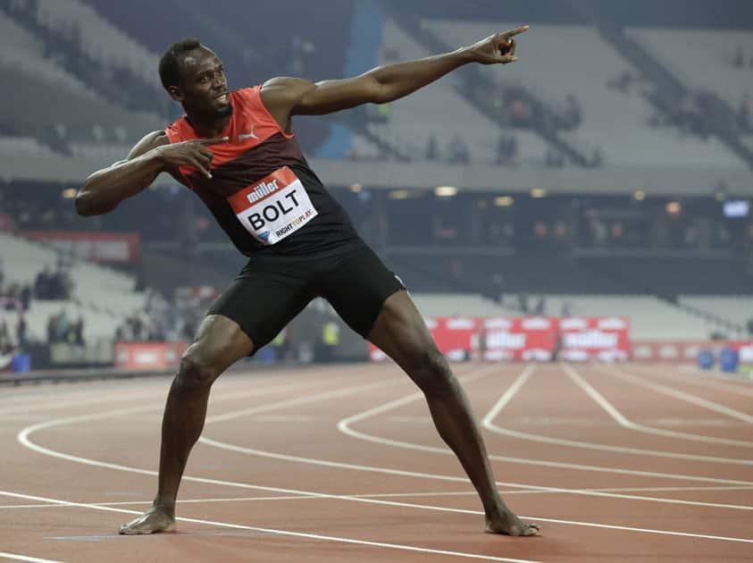 Usain Bolt of Jamaica poses for photographers