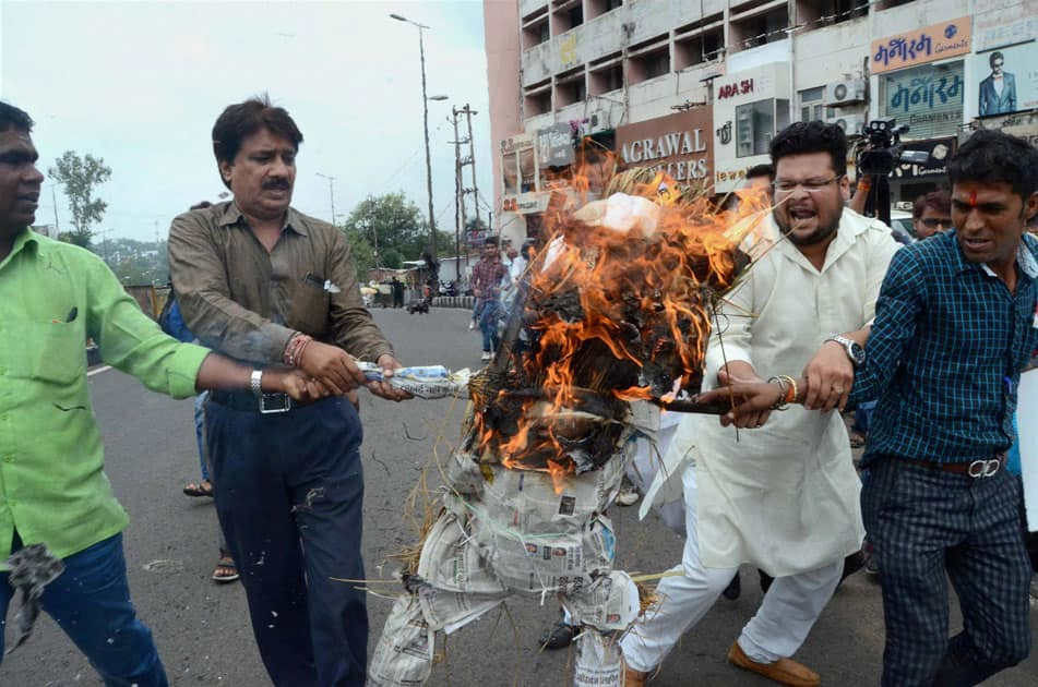 Congress party workers burn an effigy of Prime Minister