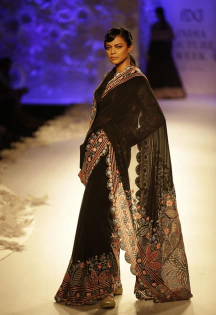 A model displays a creation by Rahul Mishra