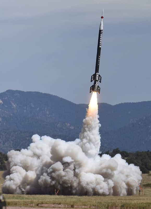 A 50-foot tall sport rocket built by interns and students takes off from Ft. Carson near Colorado Springs, Colo.