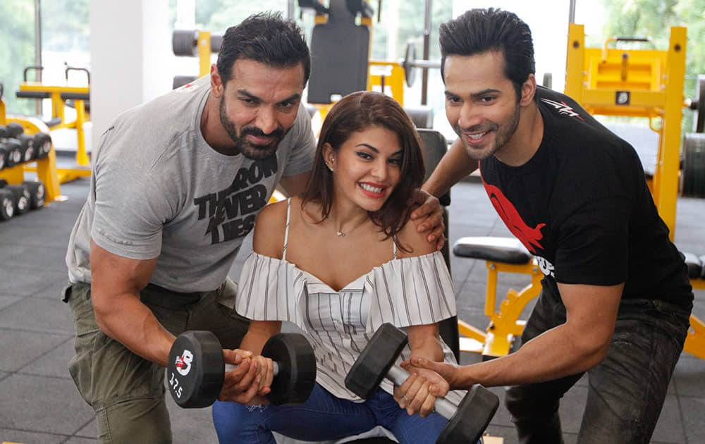 John Abraham, Varun Dhawan and Jacqueline Fernandez, pose during a press conference to promote their upcoming movie