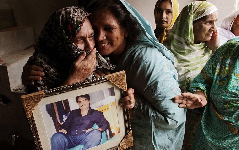 Family members of Pakistan's Zulfikar Ali celebrate as the Indonesian government halt his execution