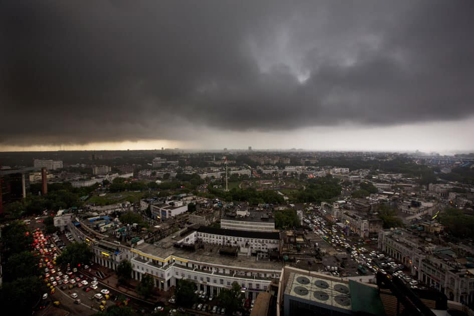 Monsoon clouds gather over the skyline of New Delhi.
