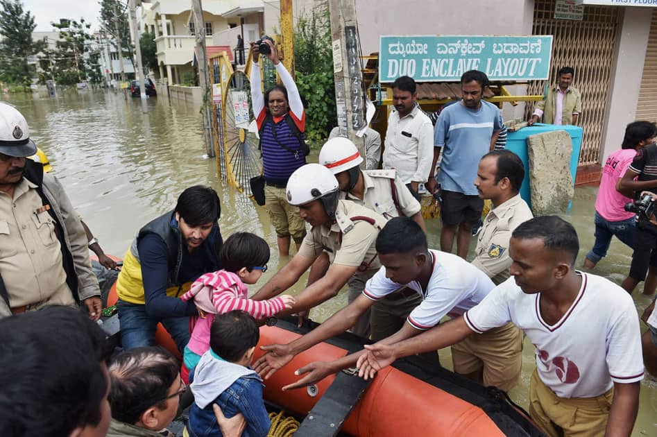 personnel rescuing the people from a flood