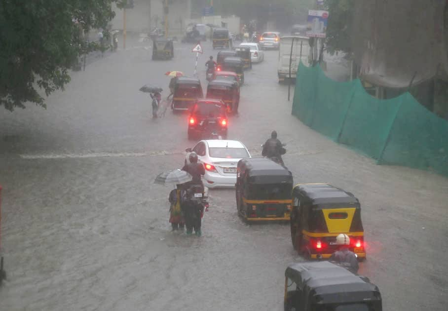 Vehicles plying at a flooded road
