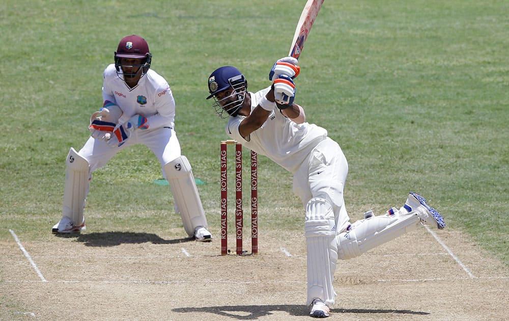 Lokesh Rahul hits a six off West Indies' Devendra Bishoo