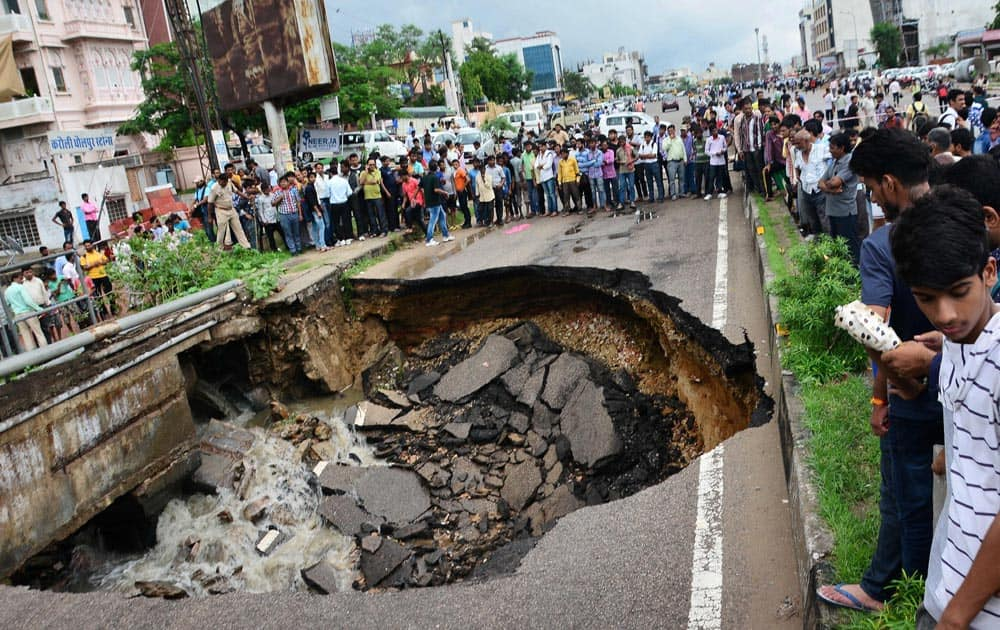 People gather collapse of a portion of Gopalpura bypass road
