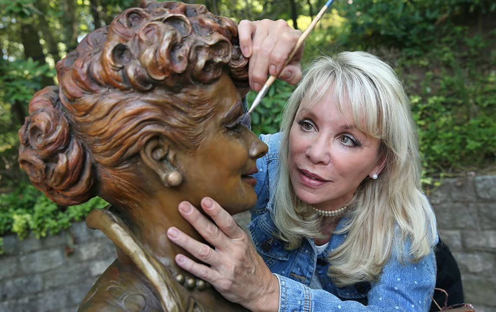 Artist Carolyn Palmer prepares to apply a cold patina to her bronze statue of Lucille Ball in Saddle River, N.J.