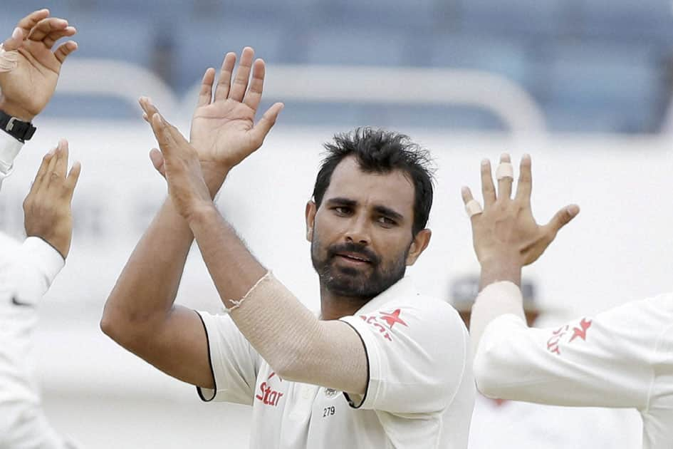 Indias bowler Mohammed Shami is congratulated by teammates