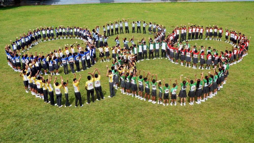 School children form Olympics rings