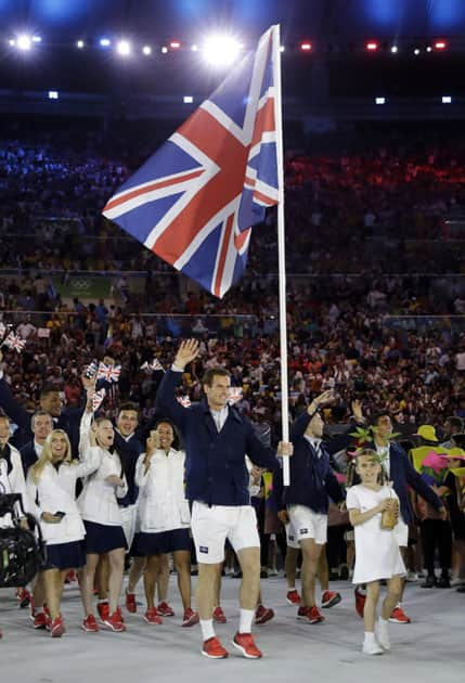 Andy Murray carries the flag of Britain