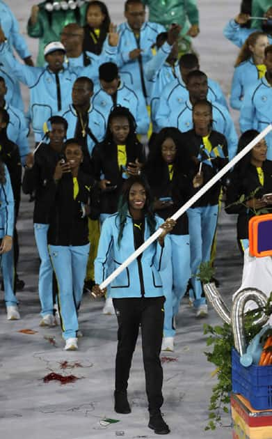 Shaune Miller carries the flag of Bahamas