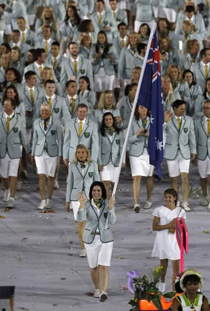Anna Meares carries the flag of Australia