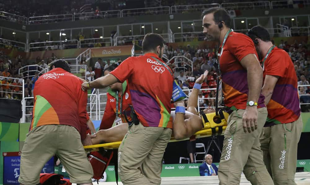 France's Samir Ait Said is carried away on a stretcher