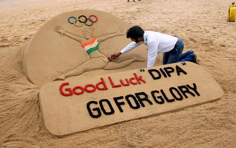 Sand artist Sudarsan Pattnaik creates a sand sculpture on Deepa Karmakar for entering into the final round in artistic gymnastic at Rio Olympic 2016