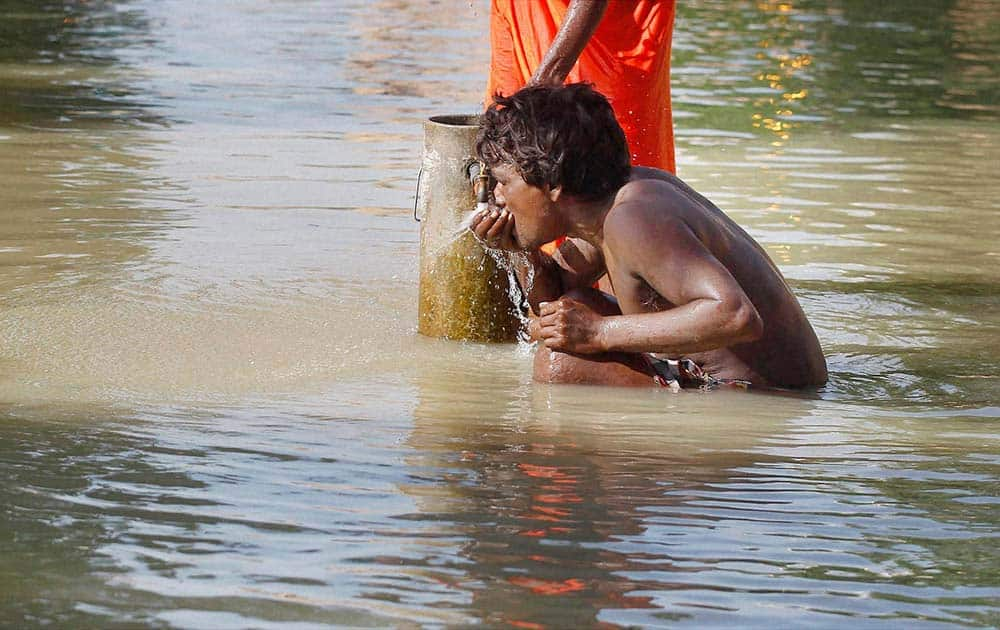 A man drinking water
