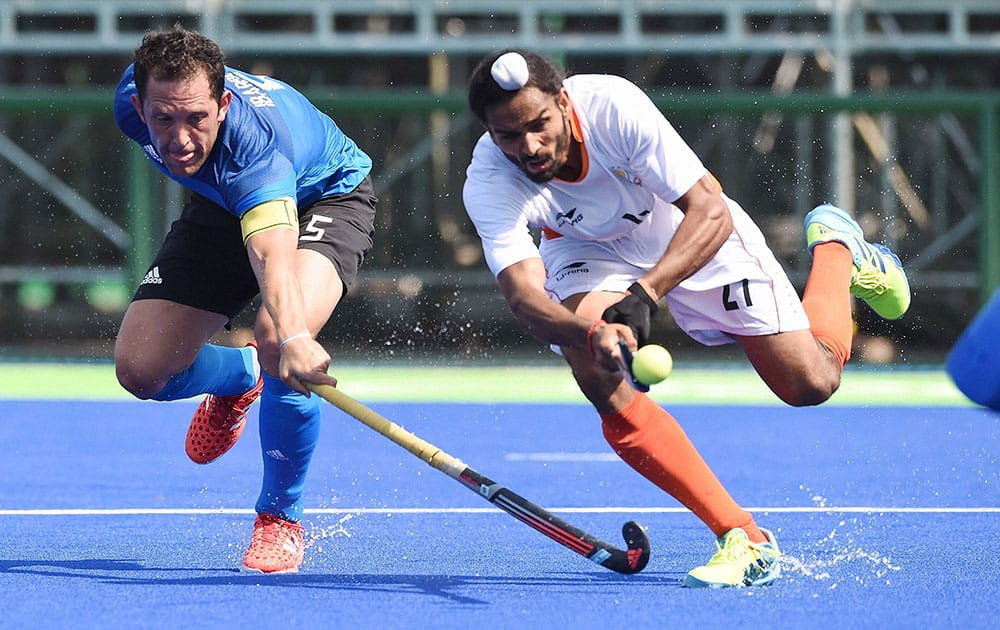 India`s Akasdeep and Argentinas Captain Pedro Ibarra during the Qualifying round match against Argentina