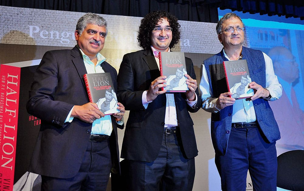 Former UIDAI chairman Nandan Nilekani and writer Ramachndra Ghuha relese the book Half Lion