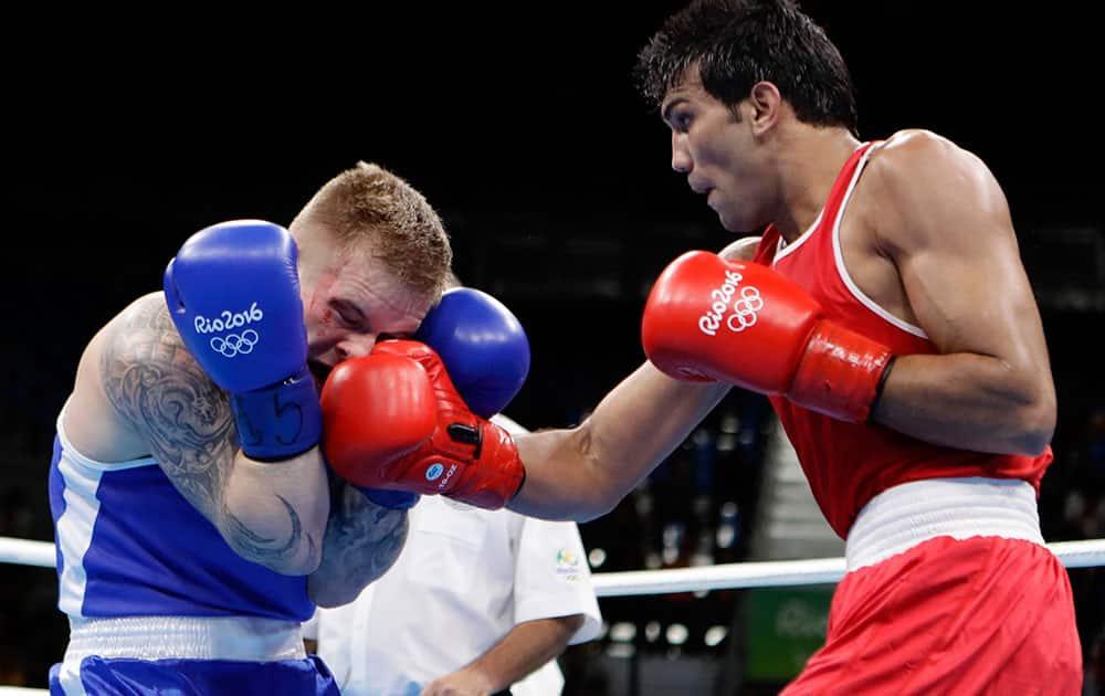 India's Manoj Kumar fights Lithuania's Evaldas Petrauskas during a men's light welterweight 64-kg preliminary boxing match