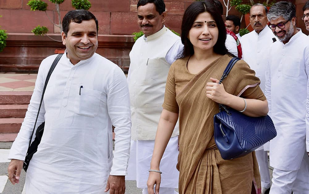 Samajwadi Party MP Dimple Yadav with party leaders at Parliament house during the monsoon session in New Delhi