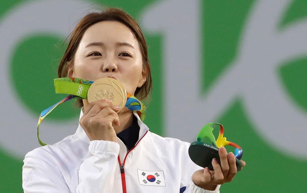 South Korea's Chang Hye-jin, kisses her gold medal at the awards ceremony of the women's individual archery competition