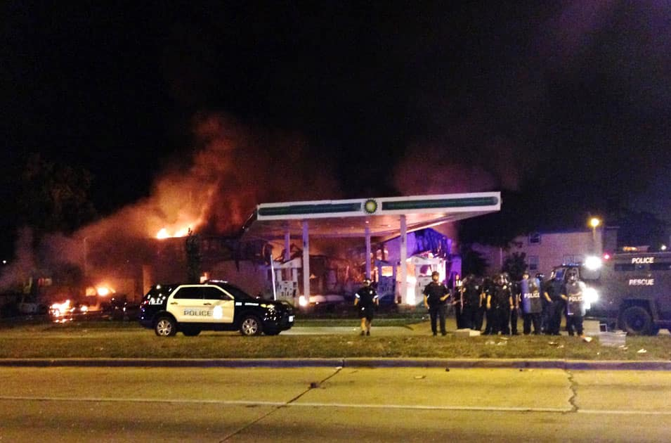 Authorities respond near a burning gas station