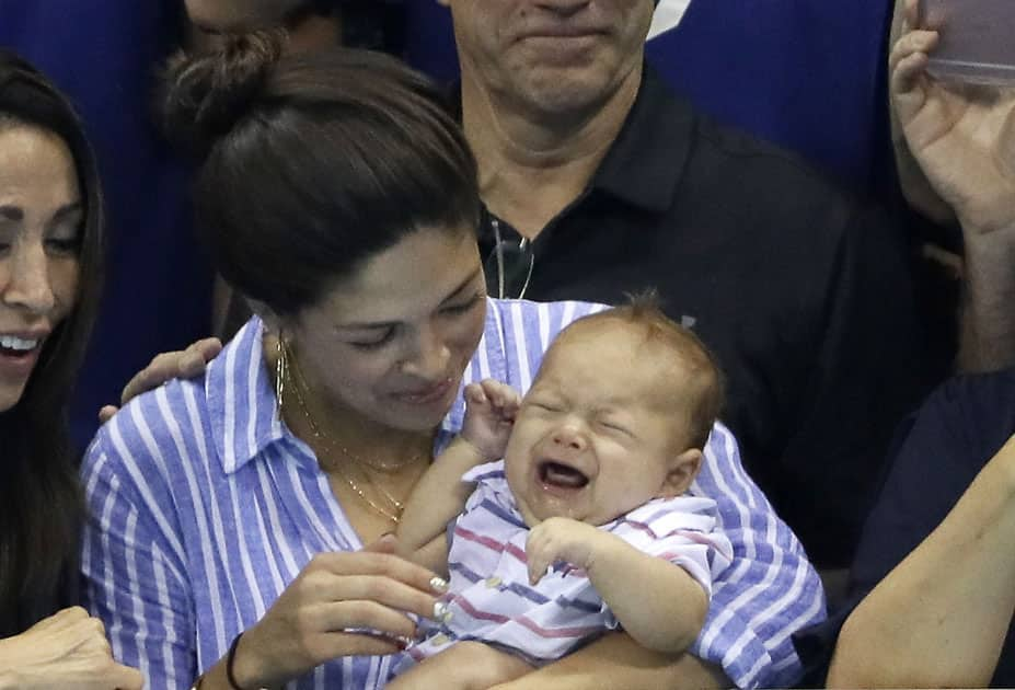Michael Phelps fiancee, Nicole Johnson, holds his baby