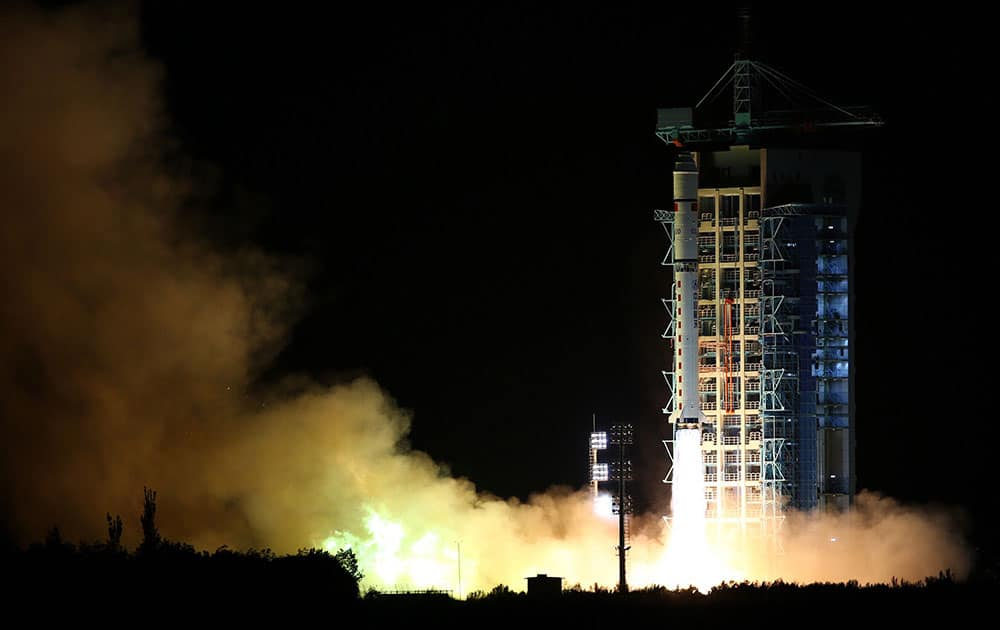 a Long March-2D rocket carrying the world's first quantum satellite lifts off from the Jiuquan Satellite Launch Center in Jiuquan, northwestern China's Gansu Province