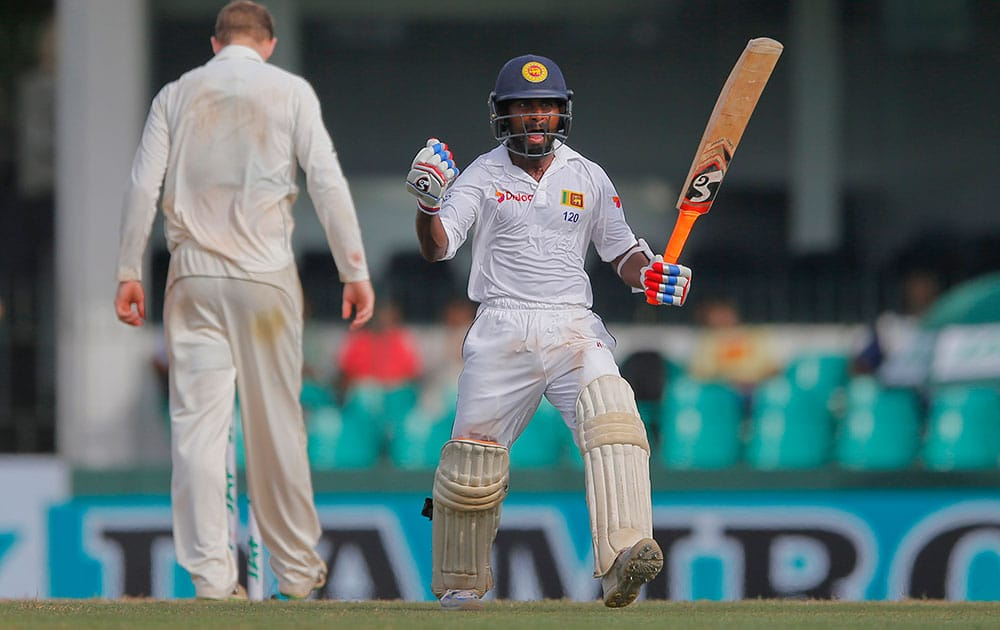 Sri Lanka's Kaushal Silva celebrates scoring a hundred against Australia