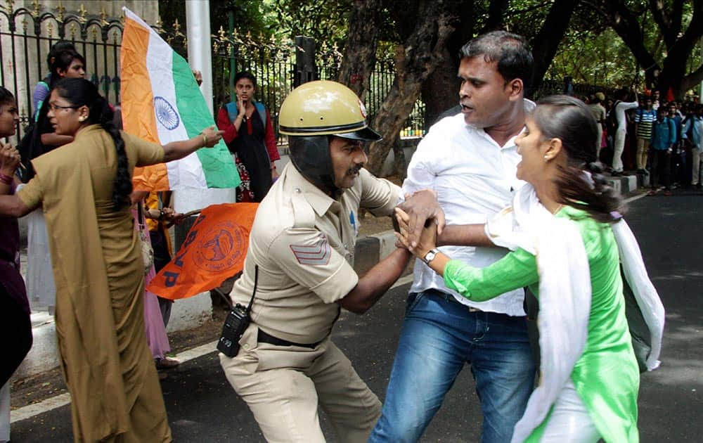 Police stop the students and ABVP activists