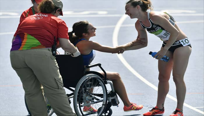 PHOTOS: Olympic Spirit! American runner Abbey D'Agostino stops to help fallen athlete during 5,000 metre run