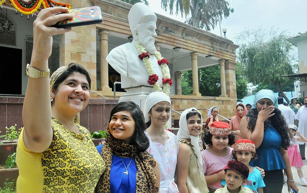 Parsi community girls taking selfie at a fire temple on the occasion of their New Year Navroze in Nagpur