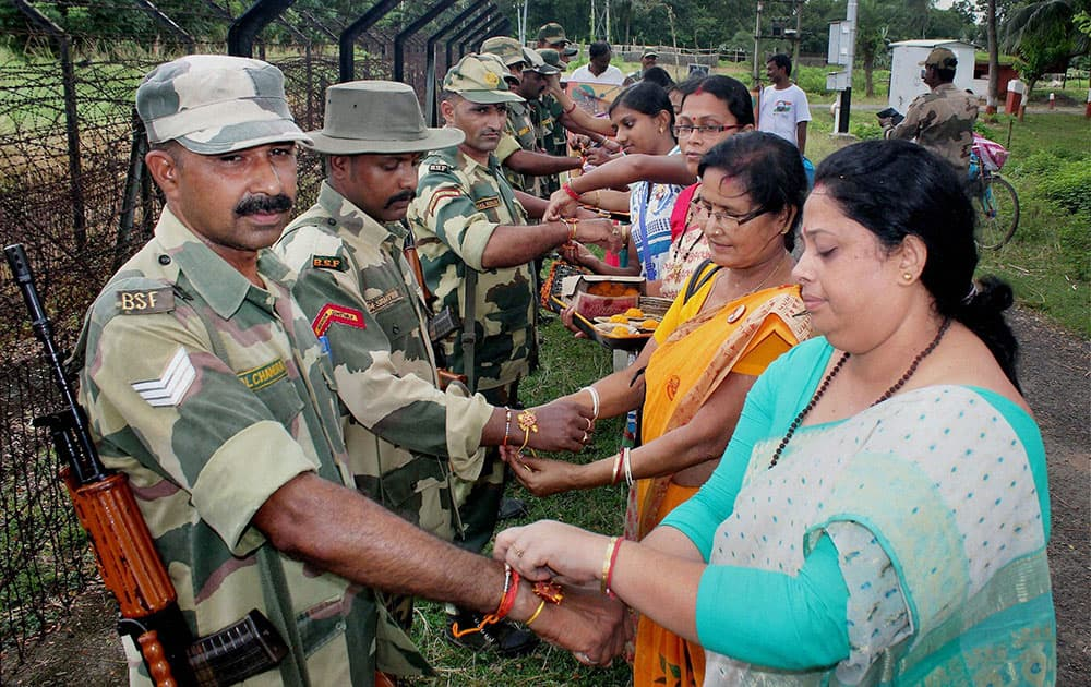 Women tying rakhis on the wrists of Border Security Force (BSF) jawans