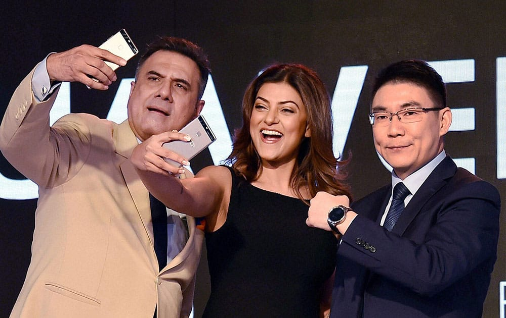 Sushmita Sen and Boman Irani along with a Huawei official during launch of Huawei P9 smartphone