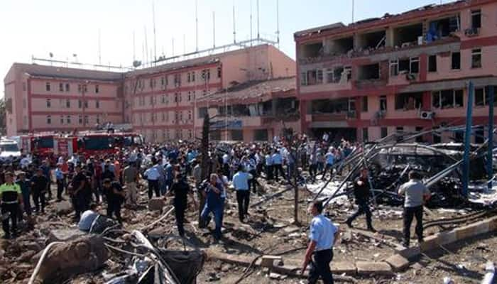 Bomb attacks targeting police, military in Turkey kill at least 14, wound 220 others
