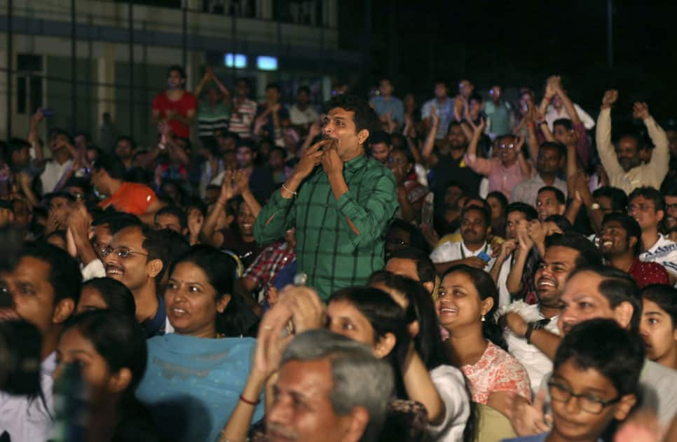 supporters of India's badminton star Pusarla Sindhu, cheer