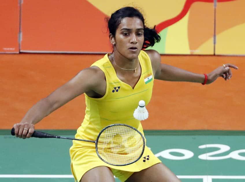 India's V. Sindhu Pusarla returns a shot to Carolina Marin