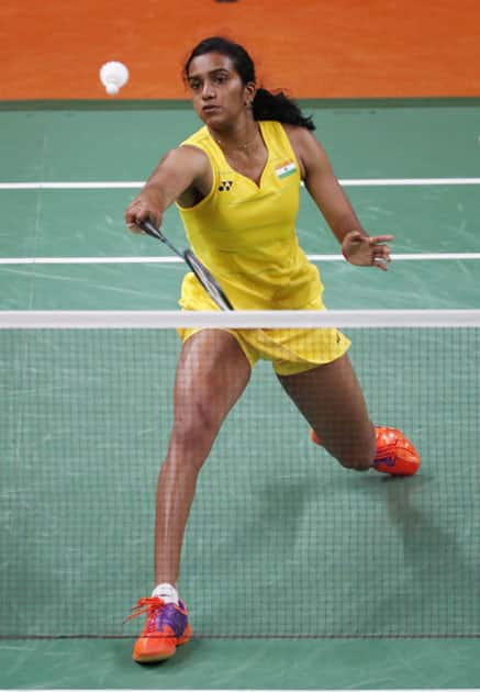 India's V. Sindhu Pusarla returns a shot