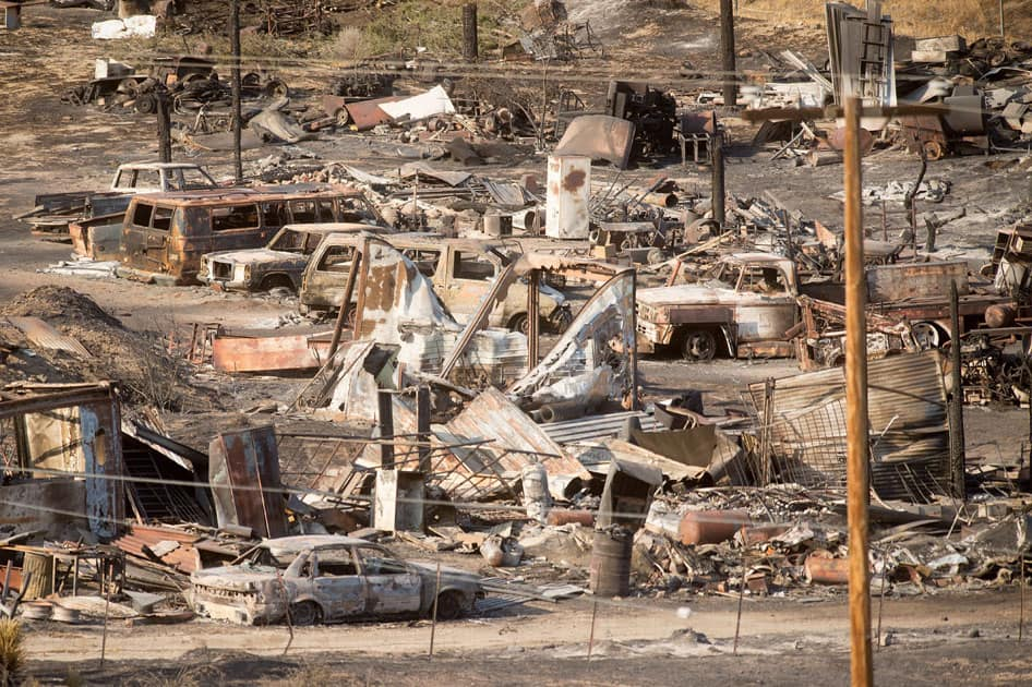 Scorched cars and trailers burned