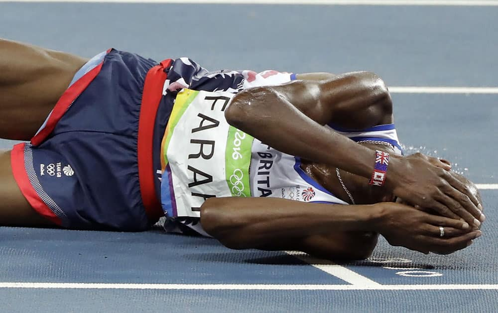 Mo Farah celebrates after winning the gold medal