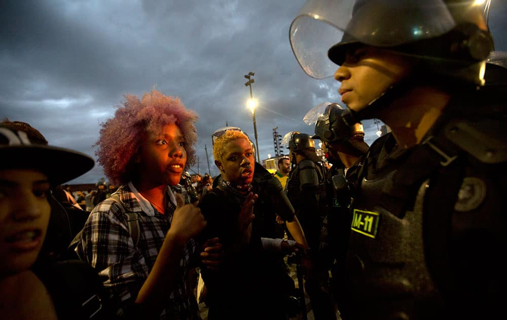 Students argue with the police during a protest against the money spent on the Rio 2016 Olympics in Rio de Janeiro, Brazil