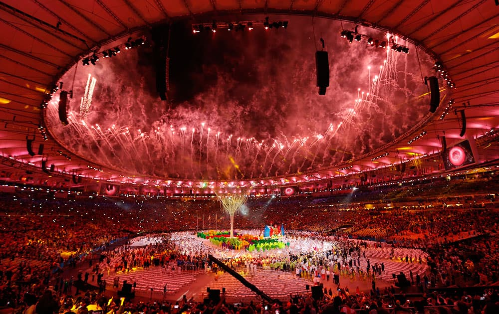 Pyrotechnics explode during the closing ceremony for the Summer Olympic