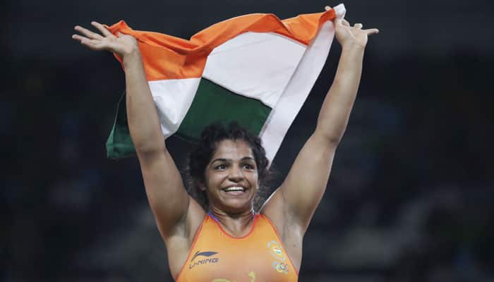 Sakshi Malik arrives to rousing reception, felicitated by Haryana government
