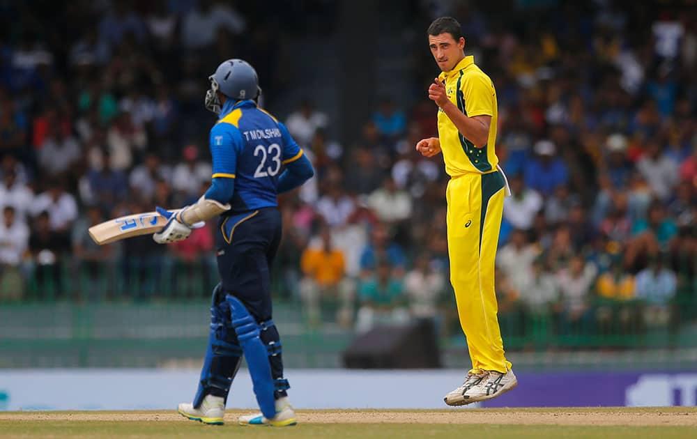 Mitchell Starc celebrates after claiming the wicket of Sri Lanka's Danushka Gunathilaka