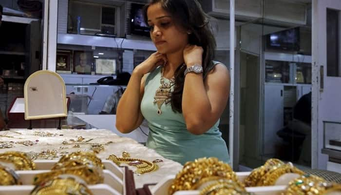 Gold price logs modest gains on jewellers' buying, overseas trend