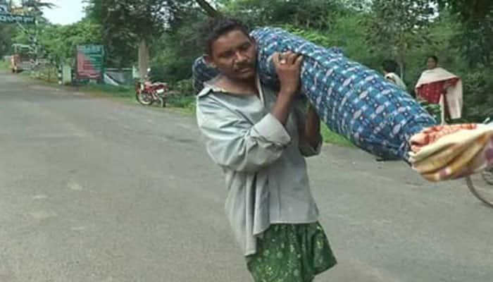 Denied help by hospital authorities, Odisha man walks 10-km carrying wife's dead body; WATCH